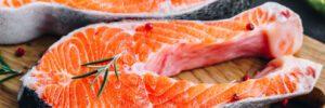 raw salmon on a cutting board